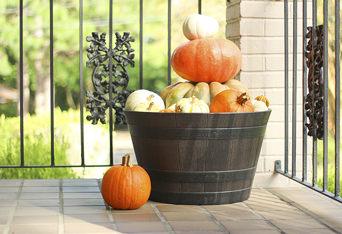 Display Pumpkins in a Whiskey Barrel for Easy Fall