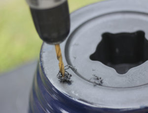 Drilling Drainage Hole in Navy Blue Resin Planter